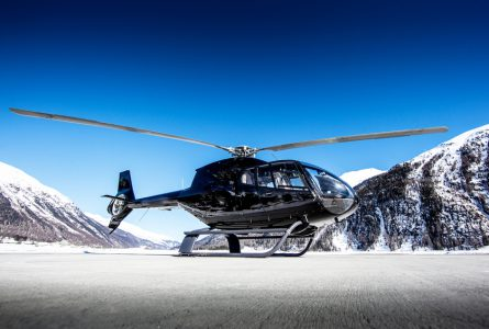 An executive helicopter on a alpine airport